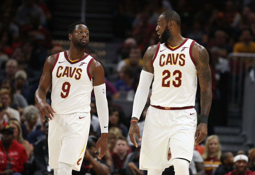 Dwyane Wade (left) and LeBron James will be seeing a lot of each other when their sons play on the same high school basketball team.