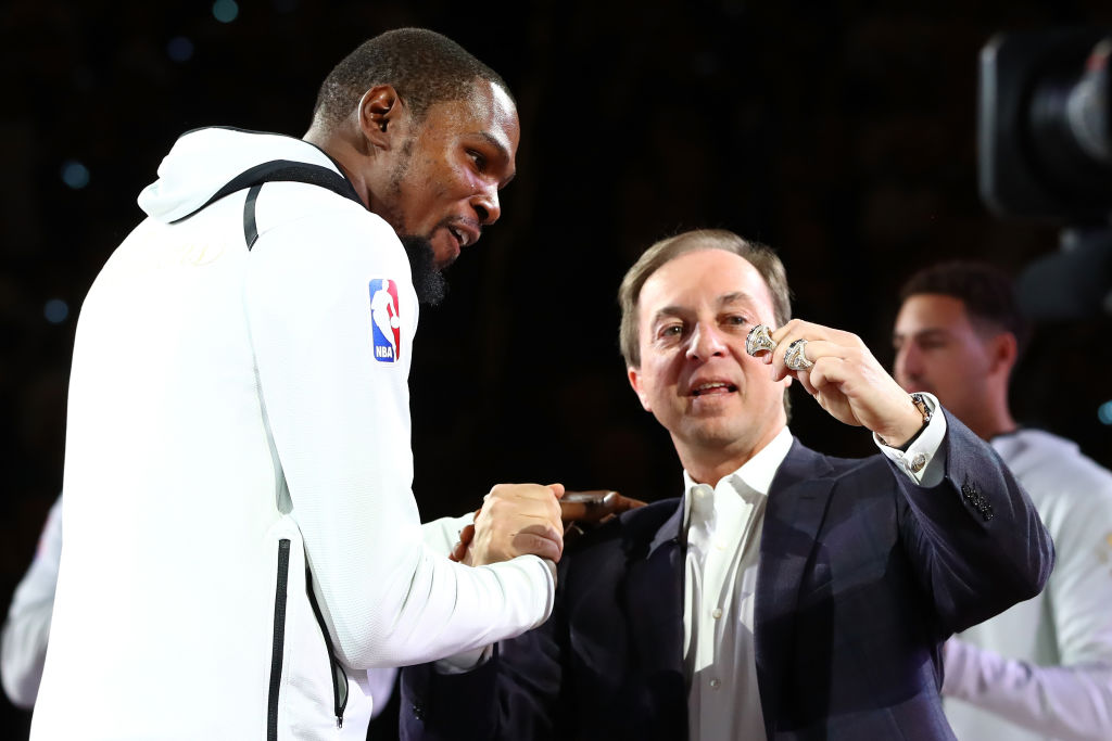 Joe Lacob (right) promised that no one will wear Kevin Durant's No. 35 Golden State Warriors jersey anytime soon.