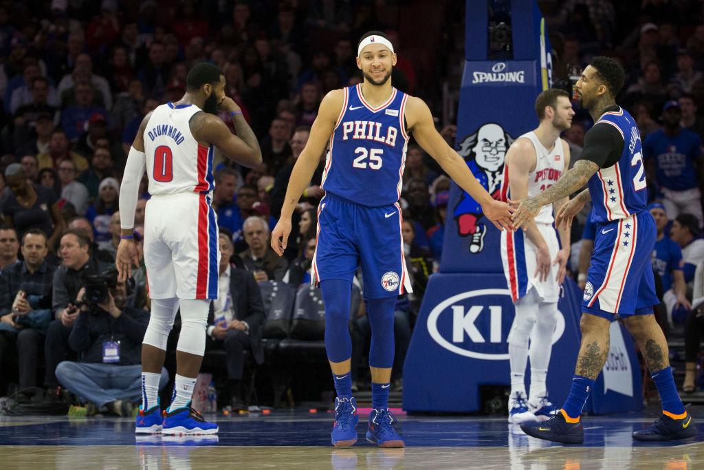 Ben Simmons high-fives his teammate