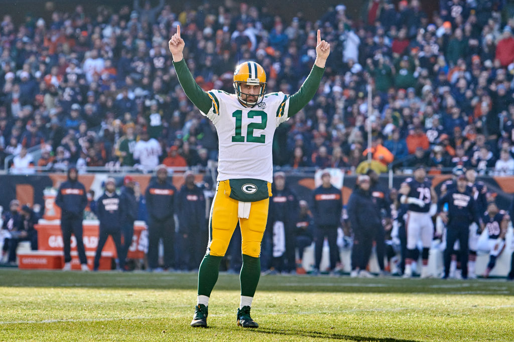 Aaron Rodgers celebrates a touchdown pass