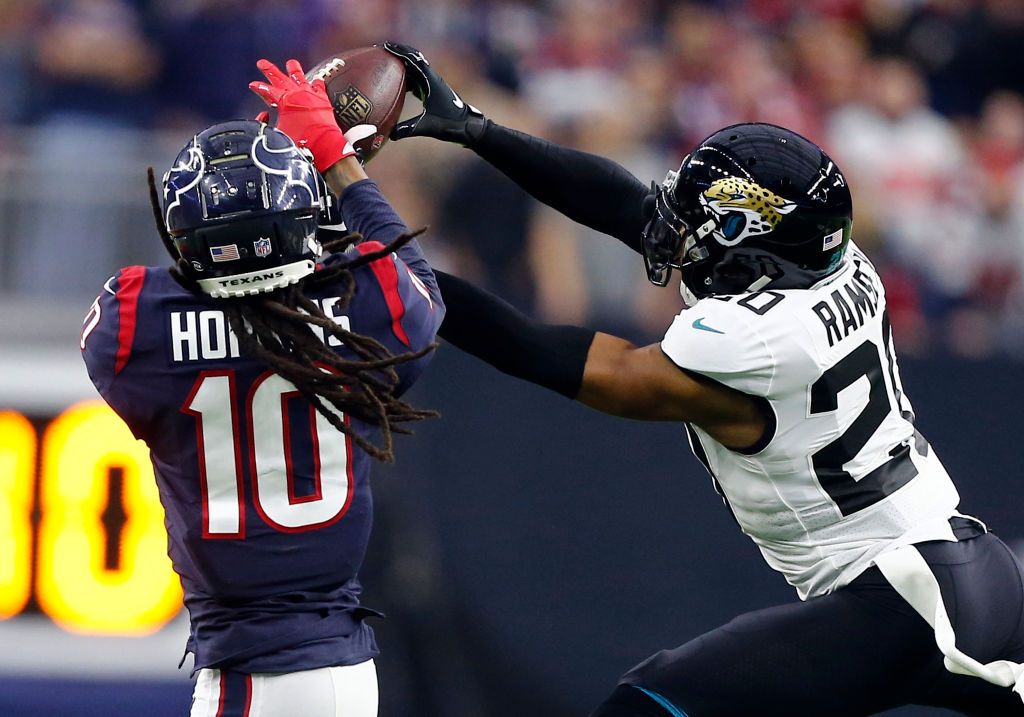 Jalen Ramsey defending a pass against DeAndre Hopkins