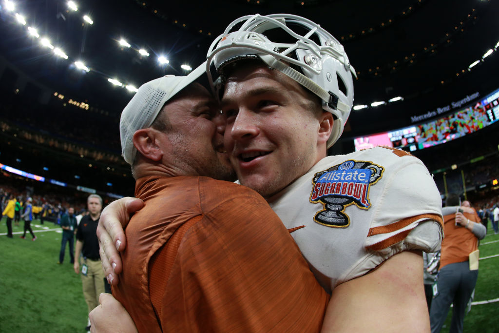 Head coach Tom Herman celebrates with Sam Ehlinger #11