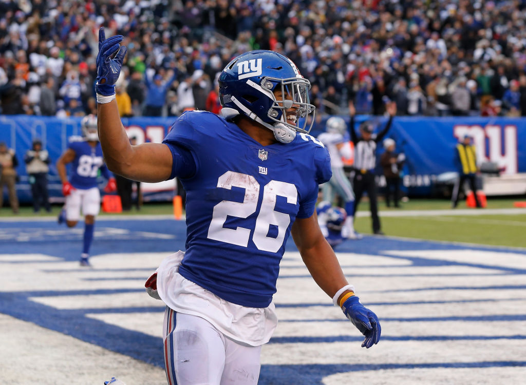 Saquon Barkley celebrates a touchdown against Dallas