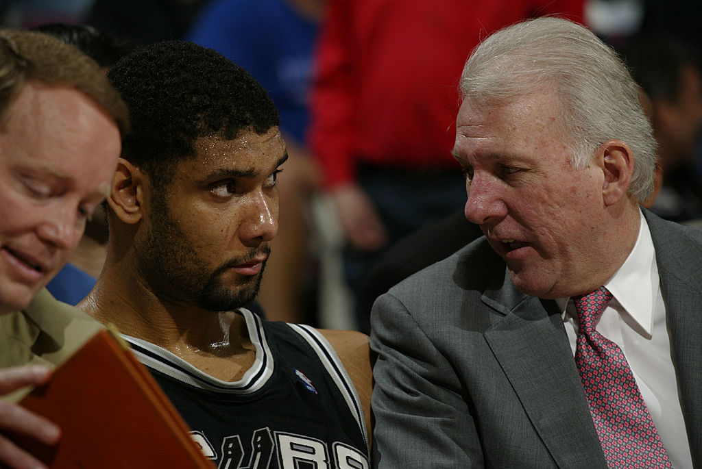 TIM DUNCAN and coach GREGG POPOVICH during Game 4 of the NBA Finals