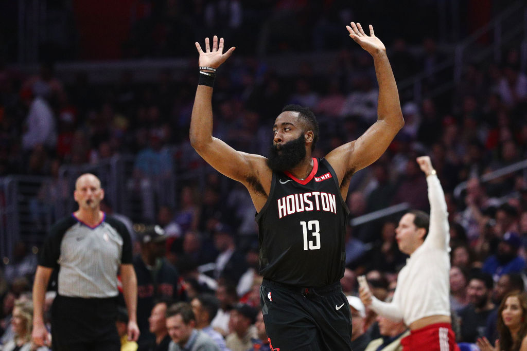 James Harden #13 of the Houston Rockets celebrates after a dunk