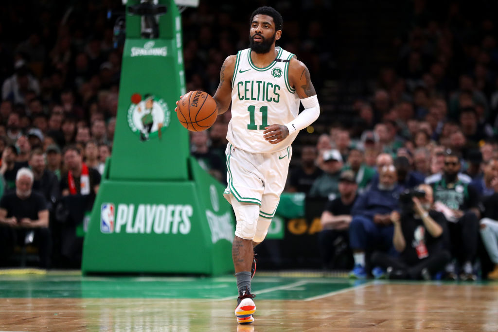 Kyrie Irving heads up the court