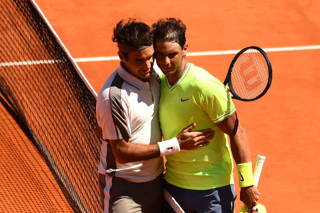 Nadal and Federer embrace after their French Open match