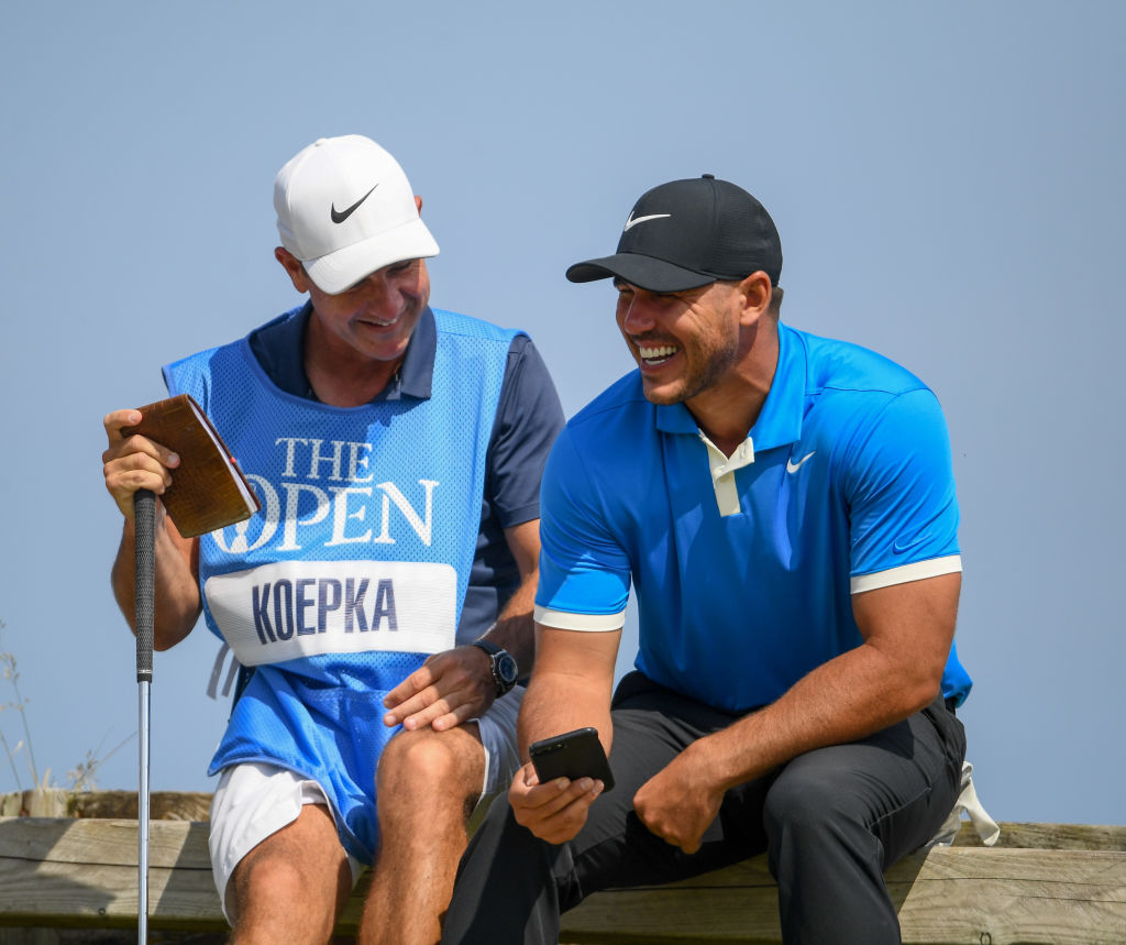 Brooks Koepka and Ricky Elliot joke around in their practice round