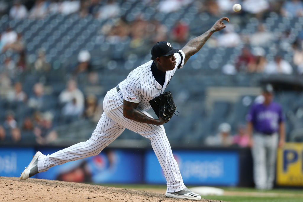 Aroldis Chapman pitches against the Colorado Rockies