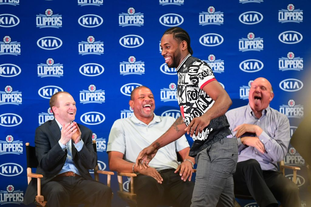 Kawhi Leonard, Doc Rivers and Steve Ballmer have a laugh at the introductory press conference
