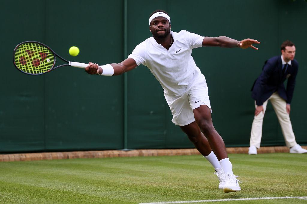 Frances Tiafoe making a play at Wimbledon