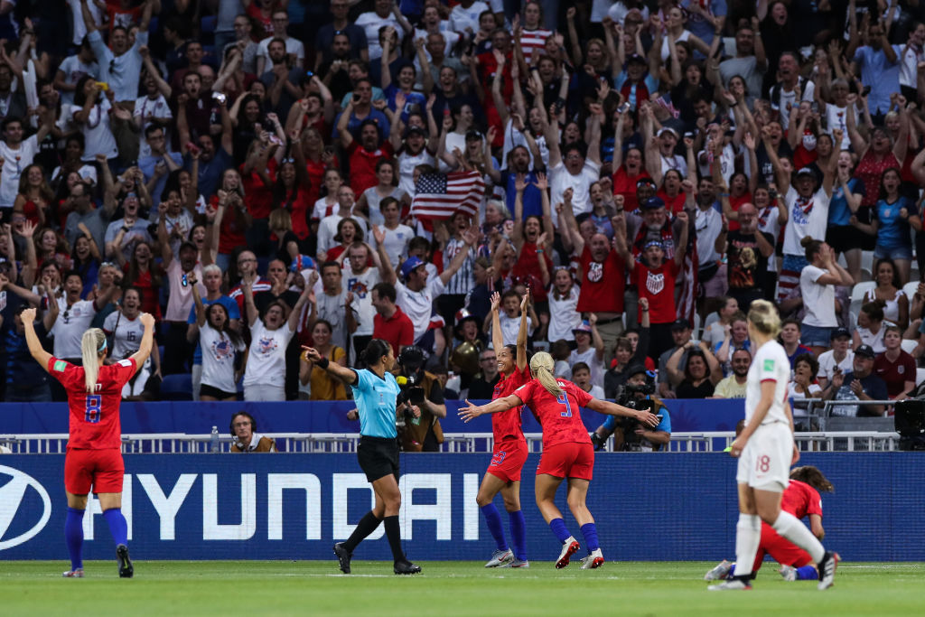 Christen Press celebrates her goal against England
