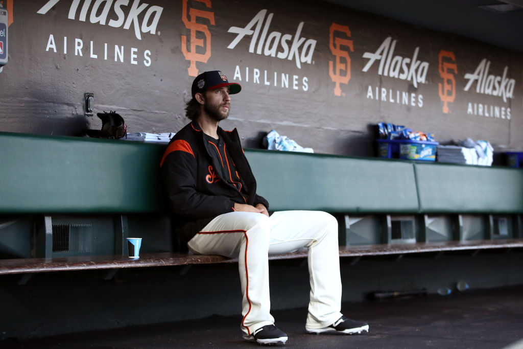 Madison Bumgarner sitting in the dugout before the game against the St. Louis Cardinals