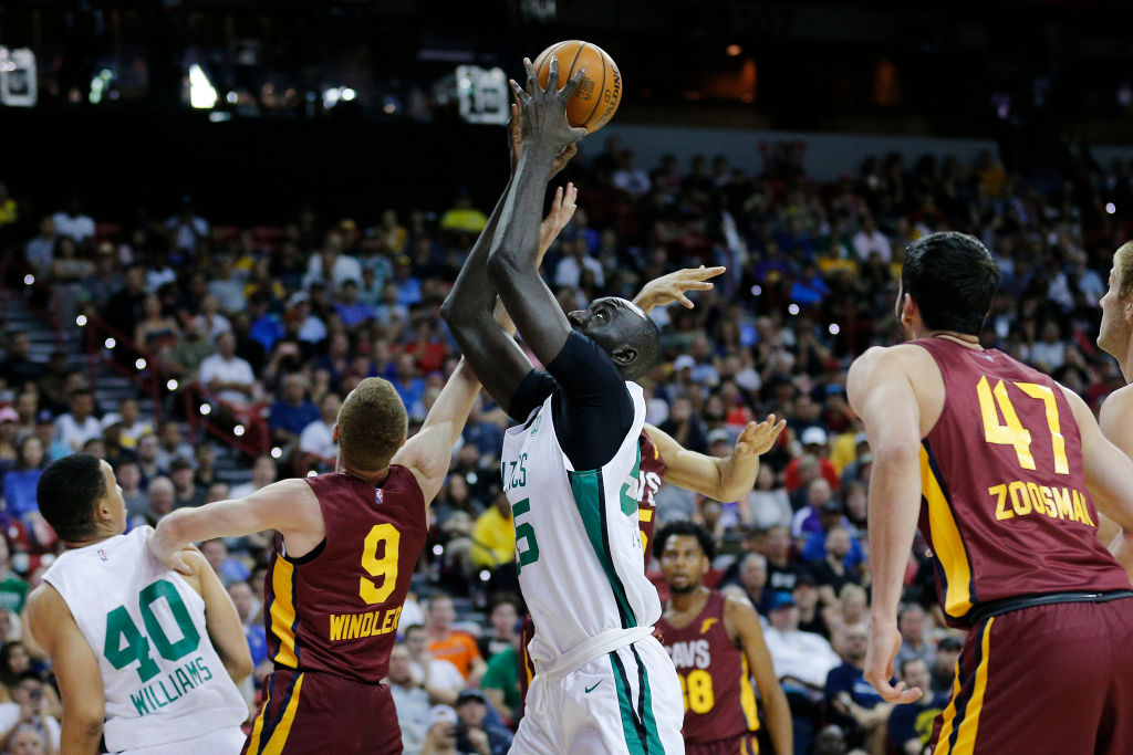 Tacko Fall grabs a rebound over the Cleveland Cavaliers
