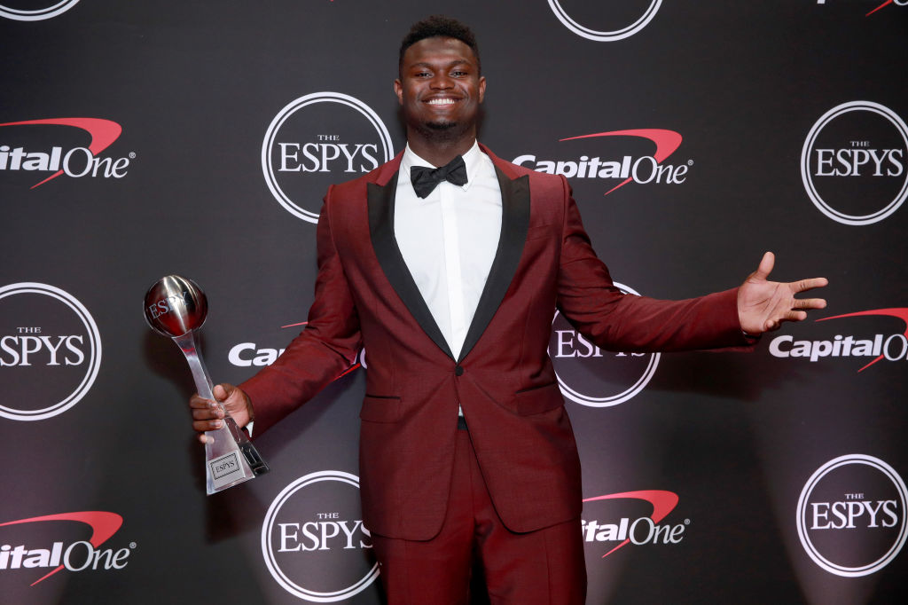 Zion Williamson poses with his ESPY for Best College Athlete