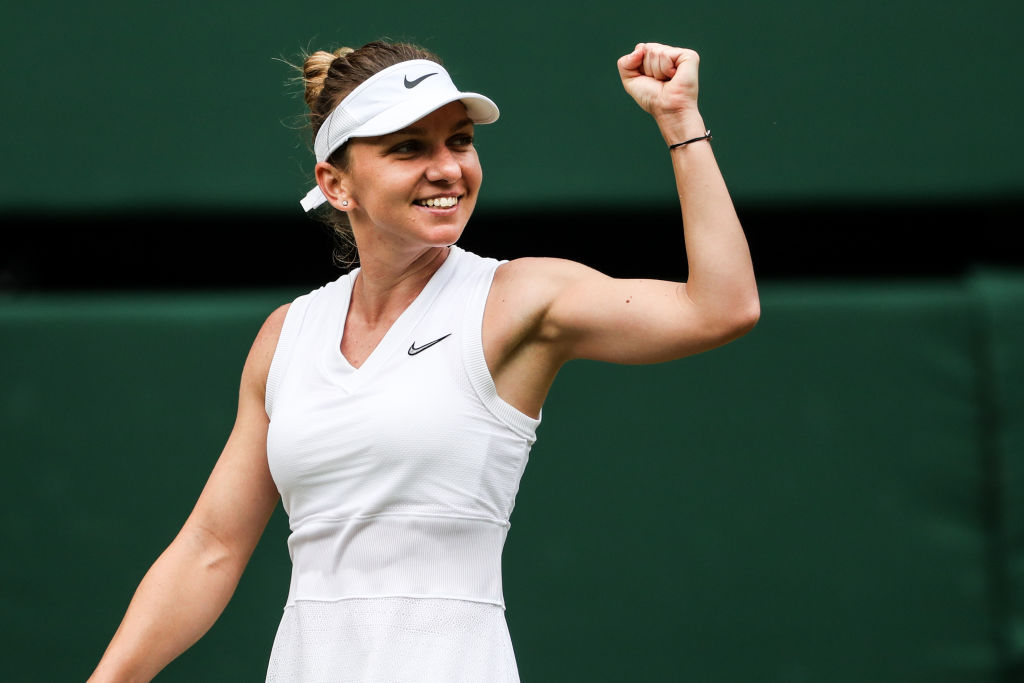 Simona Halep celebrates her win over Elina Svitolina