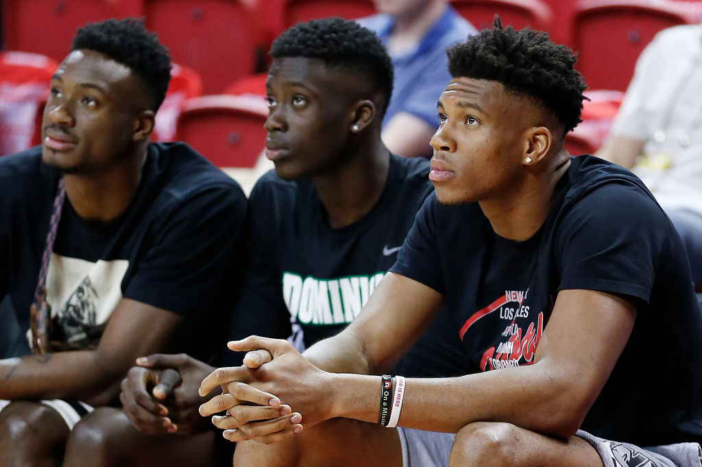 Francis (middle), Thanasis, and Giannis Antetokounmpo watch their brother Kostas play