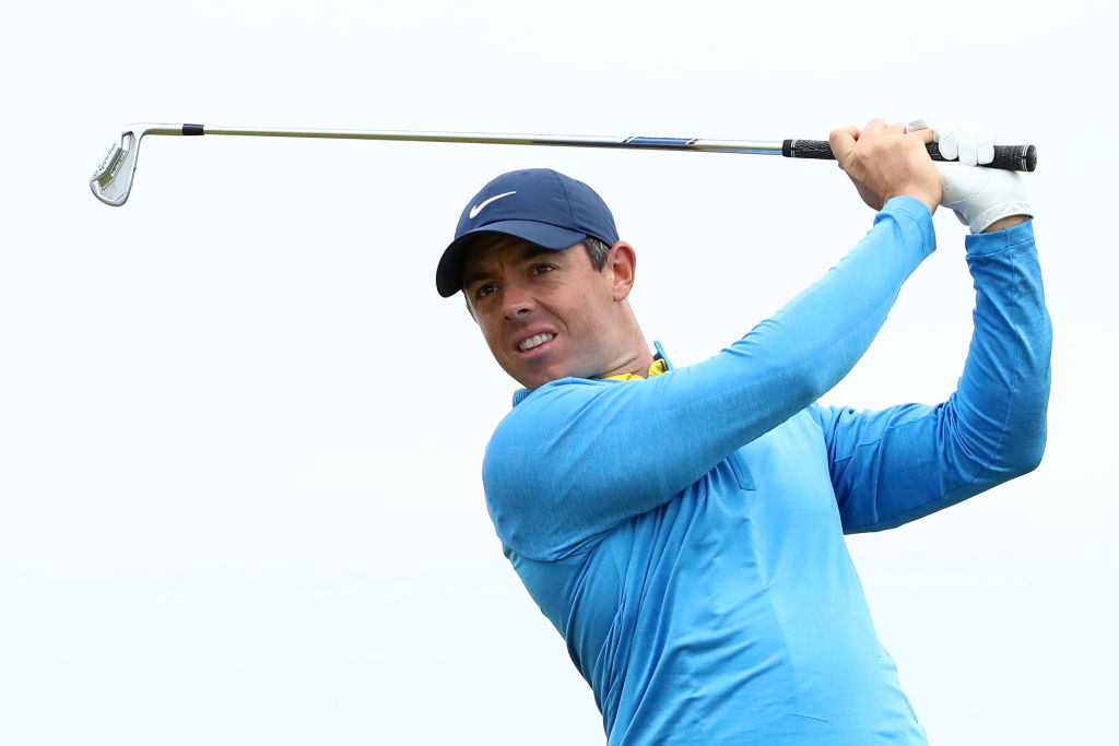 Rory McIlroy plays a shot during a practice round