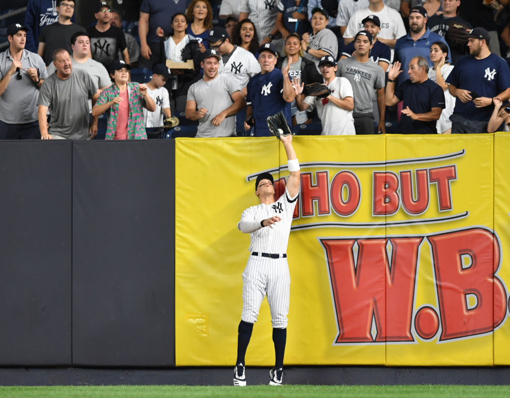 Aaron Judge catches a fly ball hit by Austin Meadows