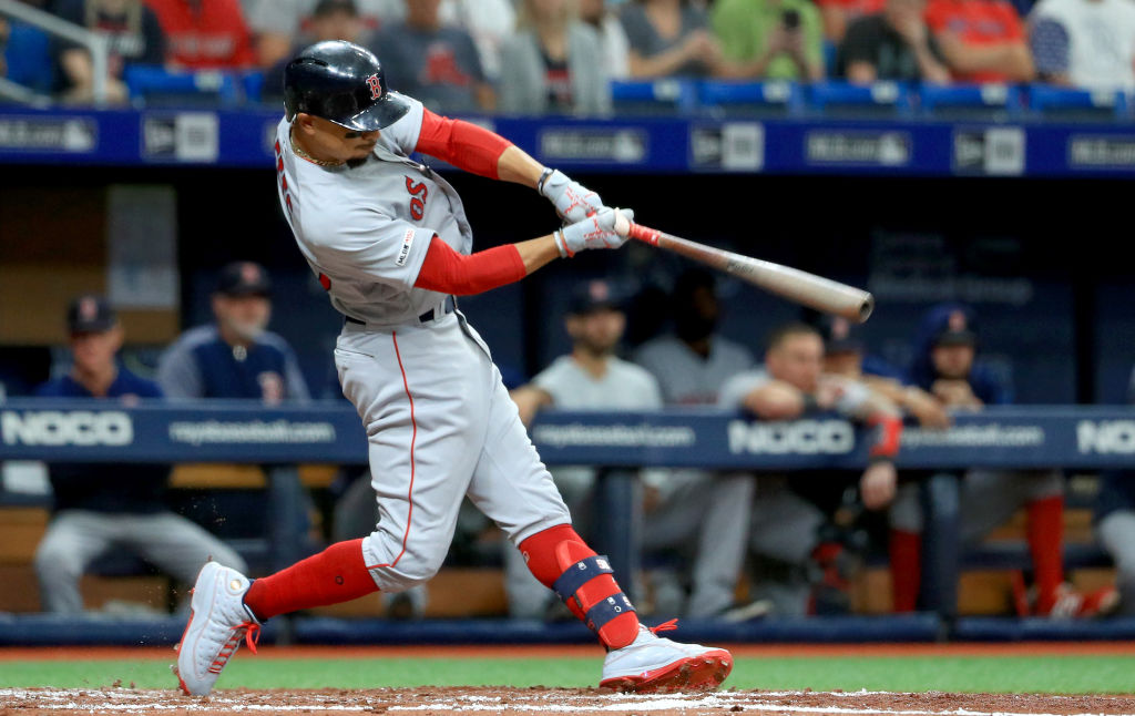 Mookie Betts hits a double against the Tampa Bay Rays