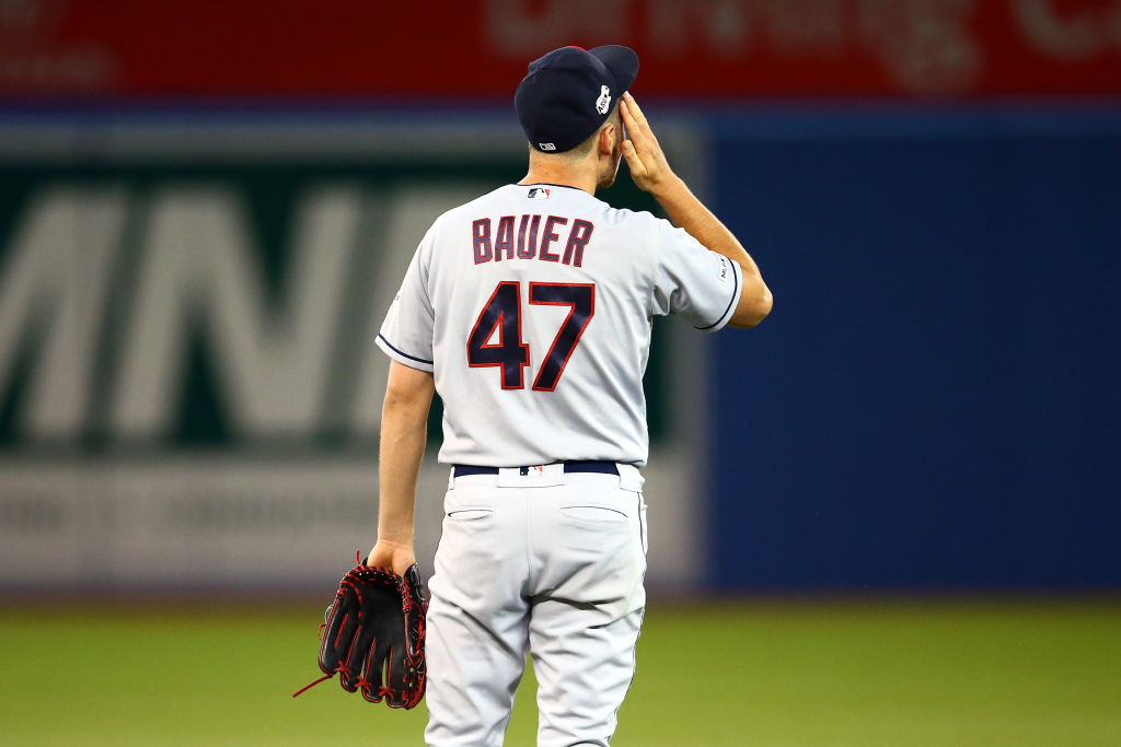 Trevor Bauer #47 of the Cleveland Indians reacts in the seventh inning