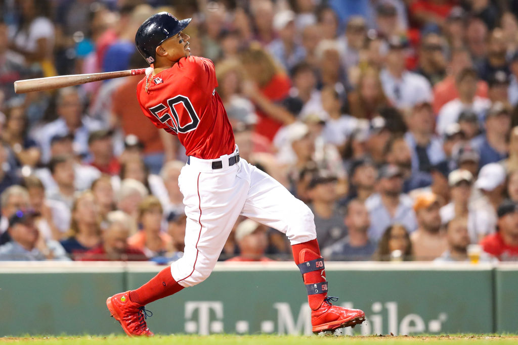 Mookie Betts #50 of the Boston Red Sox hits a two-run home run