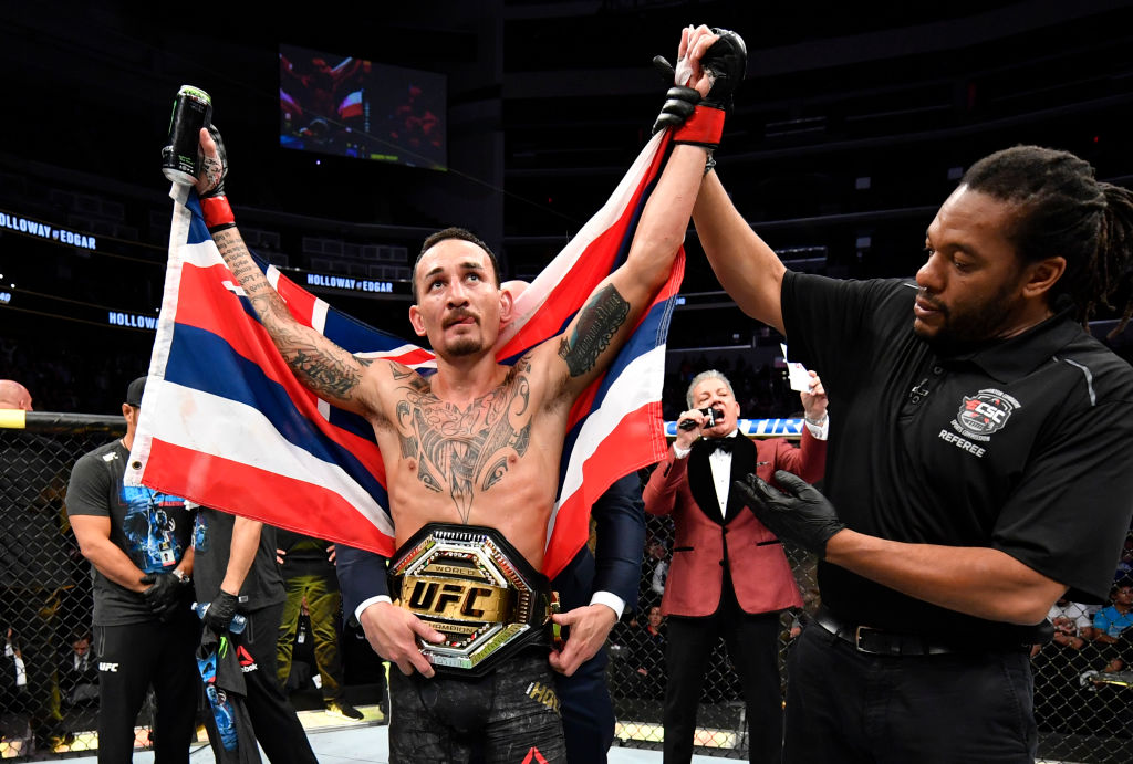 Max Holloway celebrates after defeating Frankie Edgar