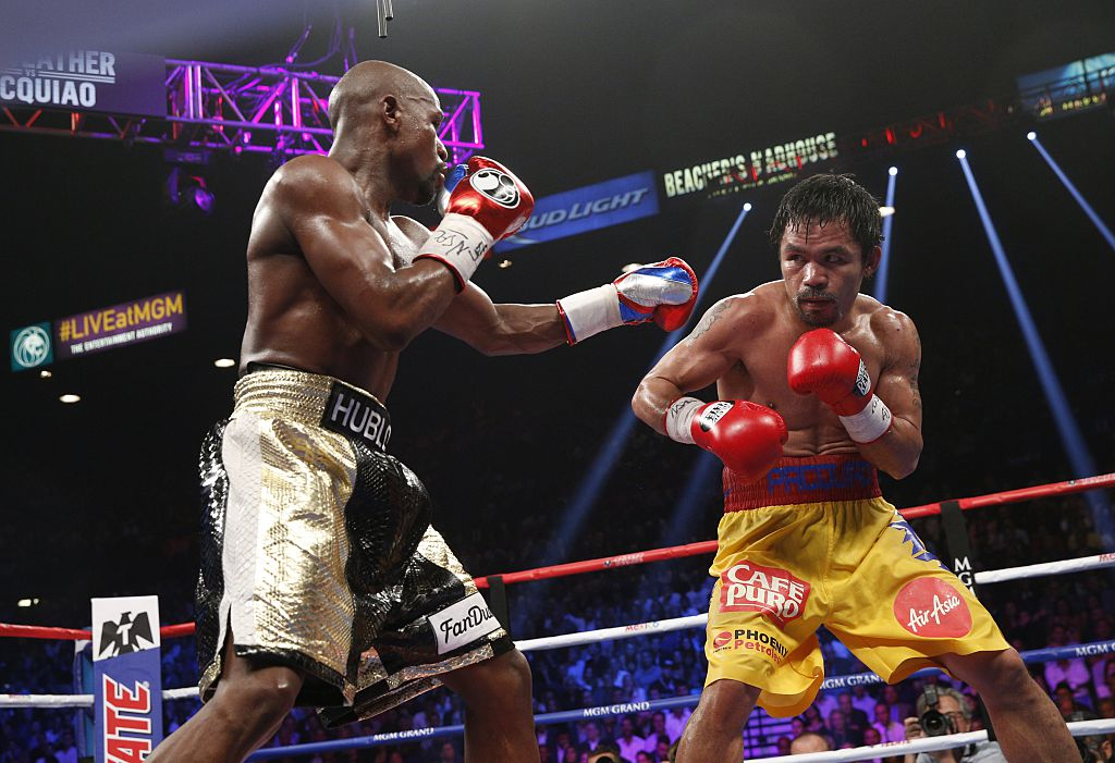 Floyd Mayweather Jr. exchanges punches with Manny Pacquiao