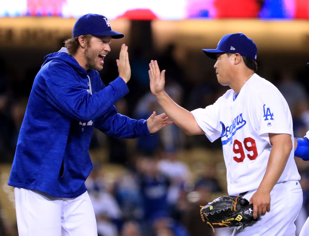 Hyun-jin Ryu and Clayton Kershaw celebrate a win