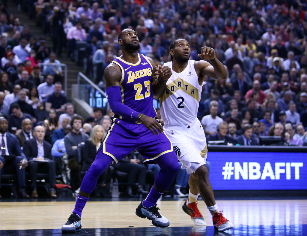 Kawhi Leonard (right) waited a long time to sign during NBA free agency in 2019, but he didn't intentionally do it to sabotage the Lakers' offseason.