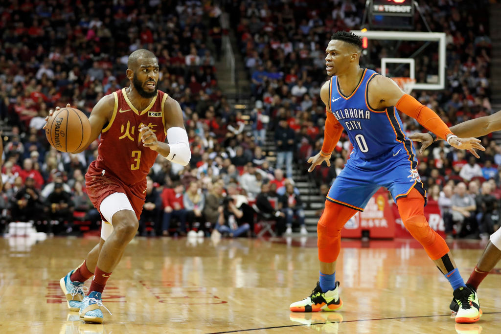 Chris Paul (left) and Russell Westbrook swap teams with Paul to the Thunder and Westbrook to the Rockets in a blockbuster trade.