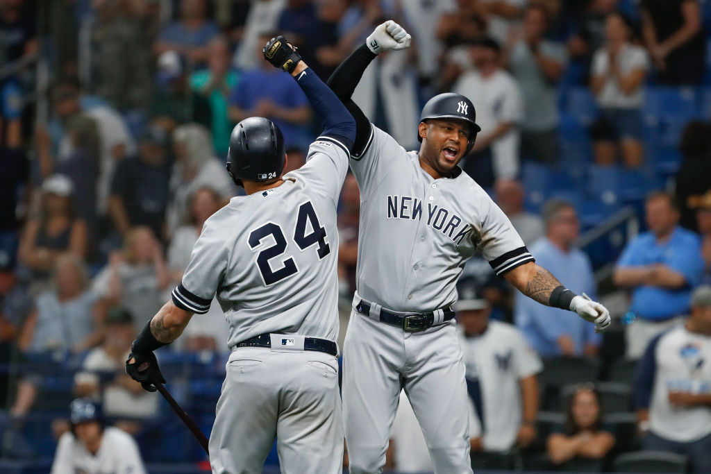 Aaron Hicks (right) and Gary Sanchez helped the Yankees set an MLB record for consecutive games with a home run.