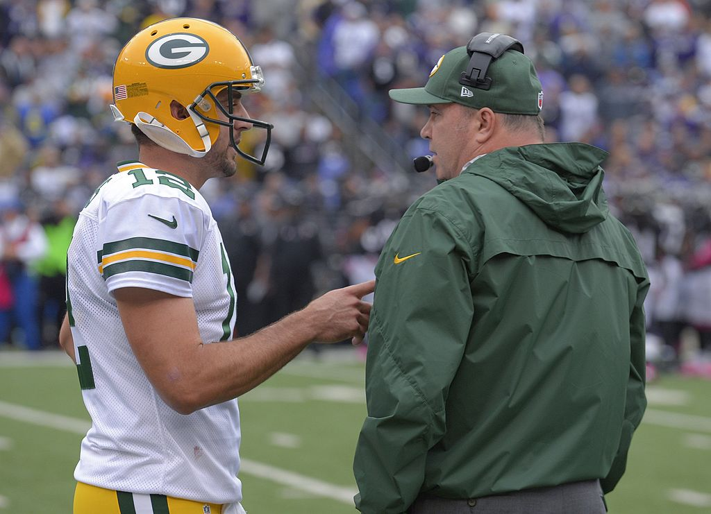 Packers quarterback Aaron Rodgers former coach Mike McCarthy (right) had run-ins at the end, but Rodgers has a good rapport with new head coach Matt LaFleur.