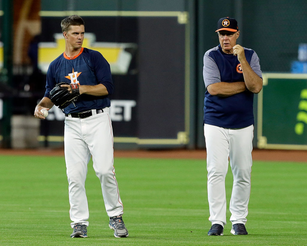 Brent Strom (right) helps make Zack Greinke and the Astros pitching staff one of the best in the game.
