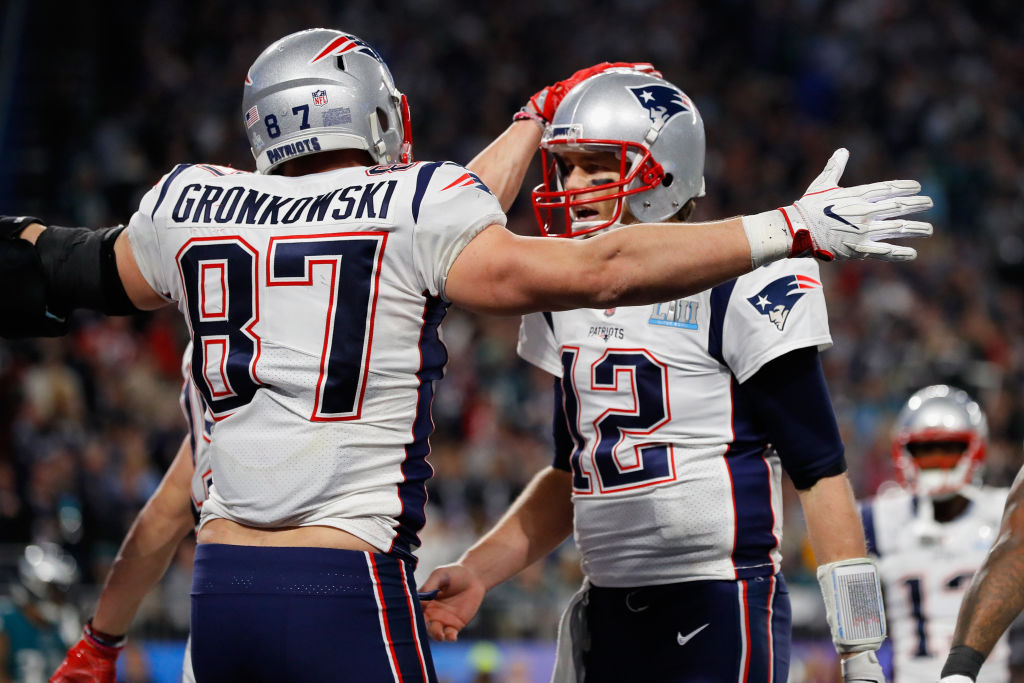 Patriots quarterback Tom Brady (right) says it will be a team effort to replace Rob Gronkowski.
