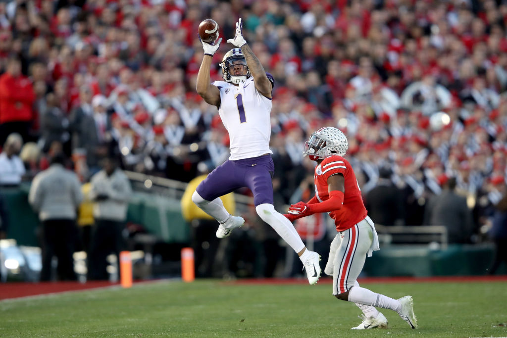 Hunter Bryant goes up for a catch in the Rose Bowl