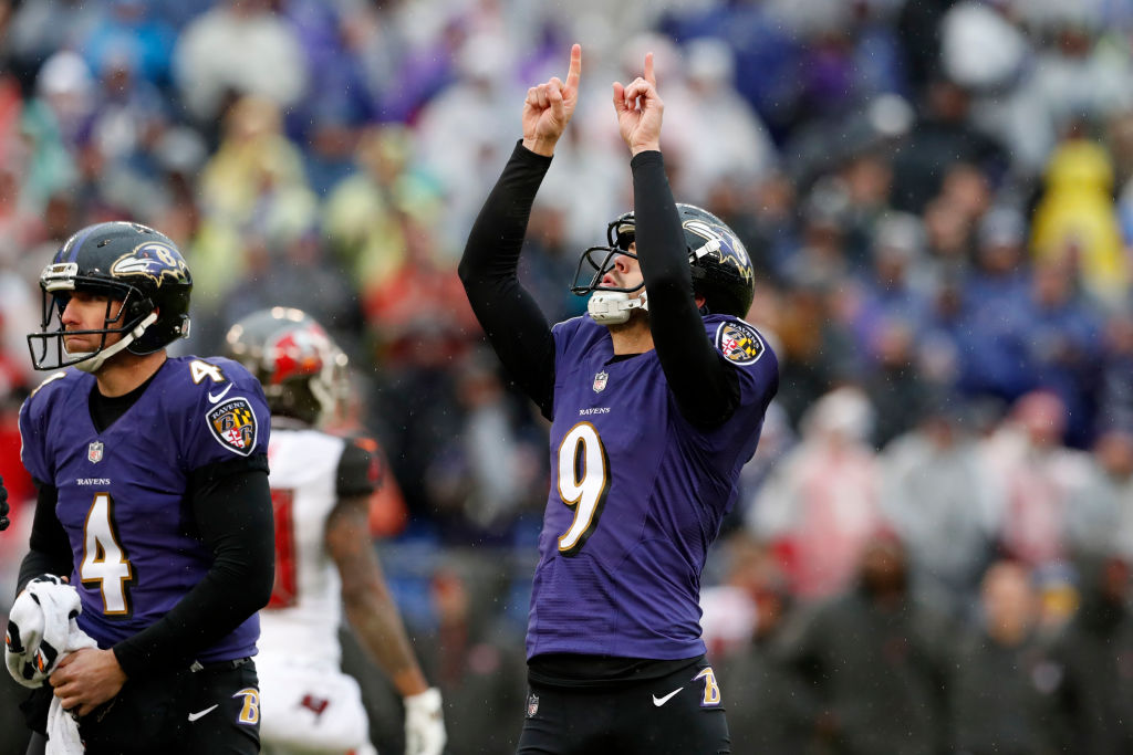 Kicker Justin Tucker #9 of the Baltimore Ravens reacts after kicking