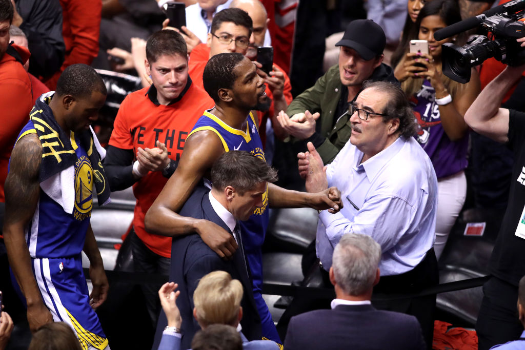 Kevin Durant #35 of the Golden State Warriors is assisted off the court