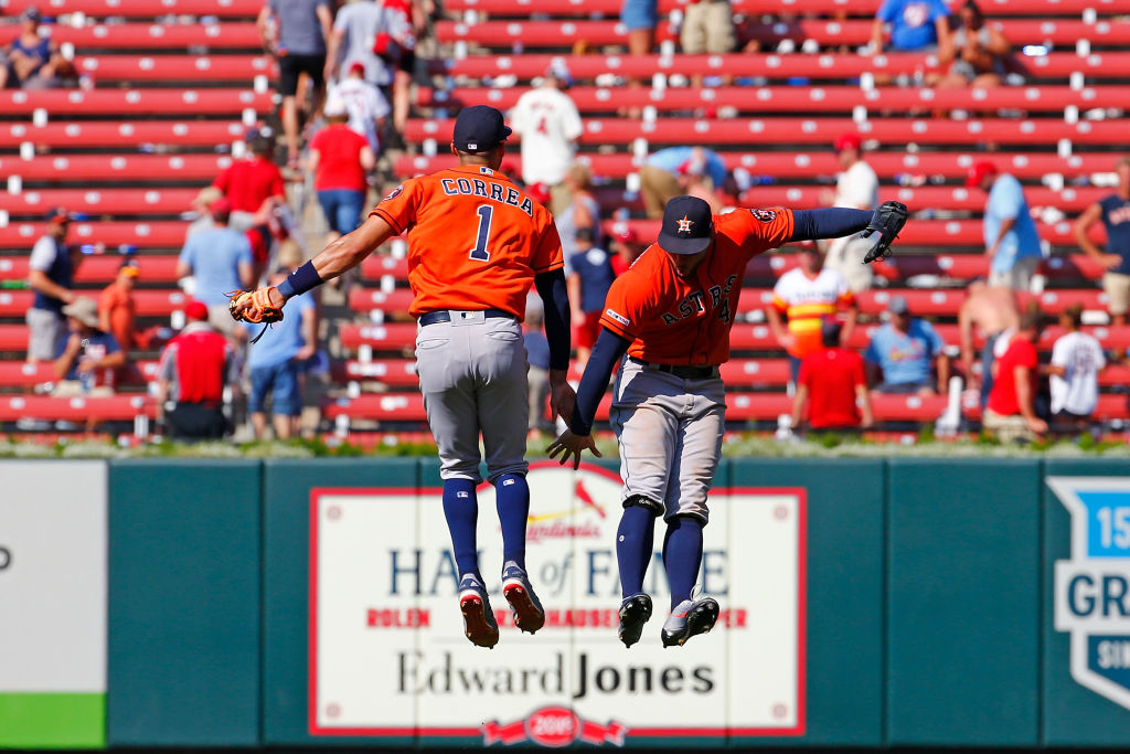 Carlos Correa and George Springer celebrate a win