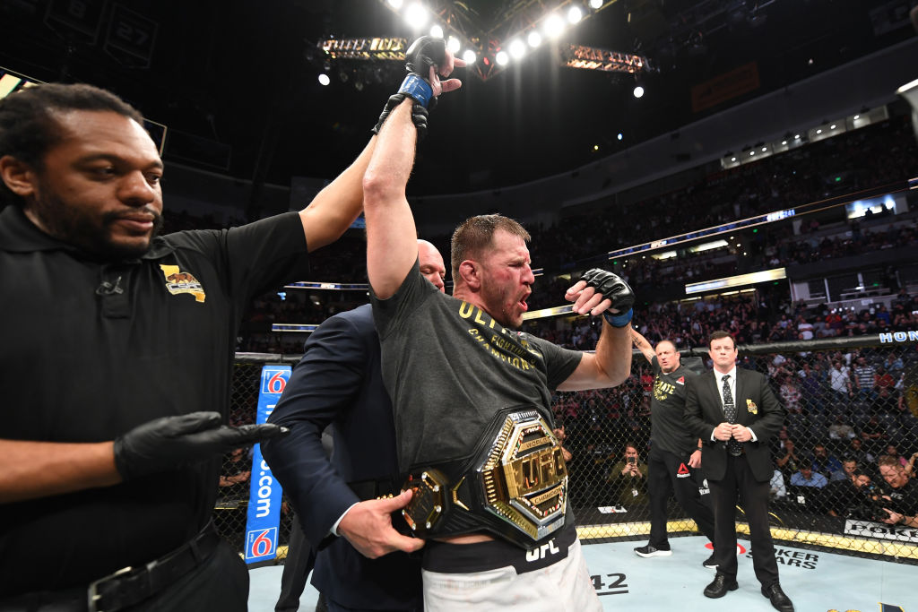Stipe Miocic celebrates his TKO victory over Daniel Cormier