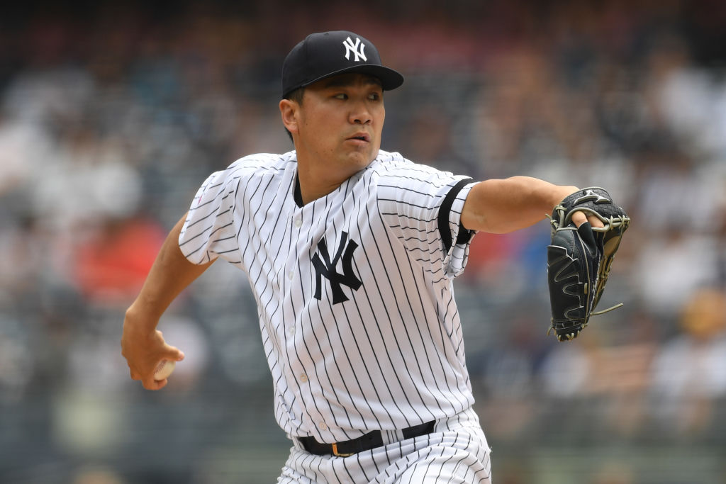 Masahiro Tanaka #19 of the New York Yankees pitches