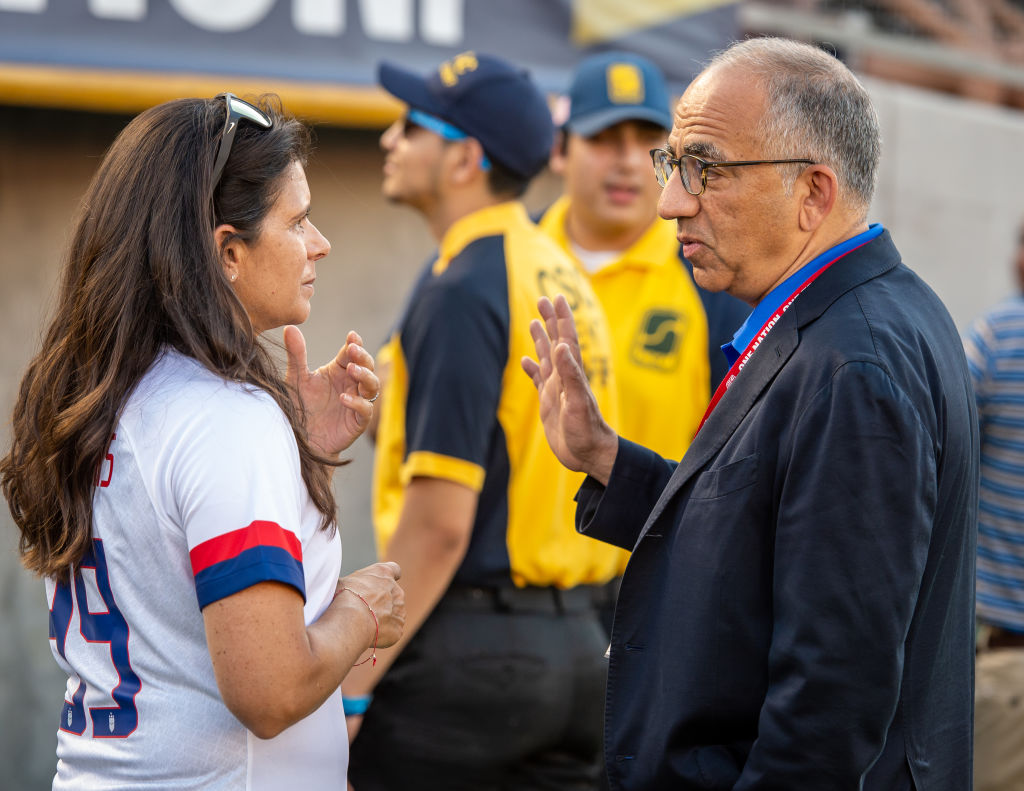 USWNT legend Mia Hamm and Carlos Cordiero having a discussion