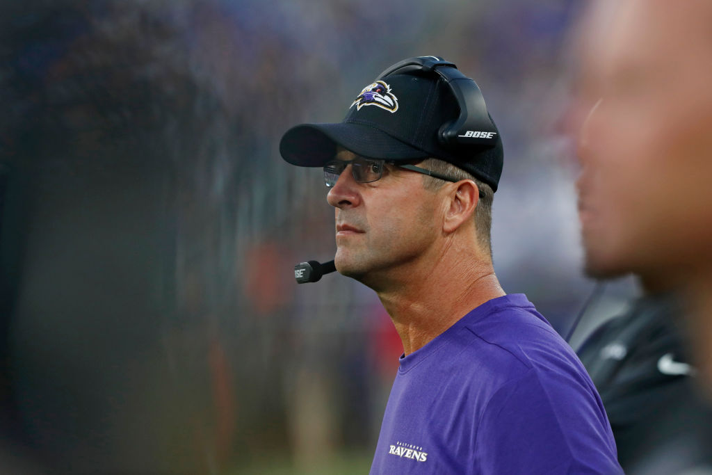 Head Coach John Harbaugh of the Baltimore Ravens looks on