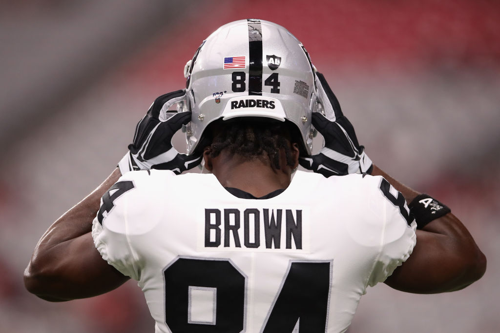 Wide receiver Antonio Brown #84 of the Oakland Raiders adjusts his helmet