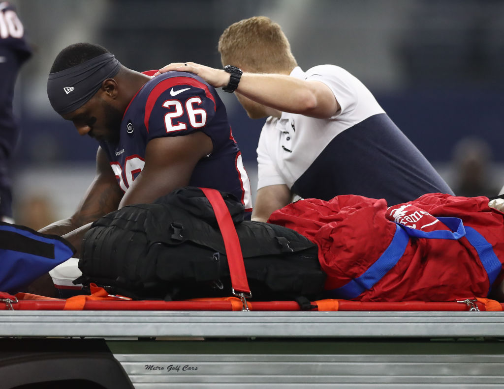 Lamar Miller was carted off the field in Houston's 34-0 loss to Dallas