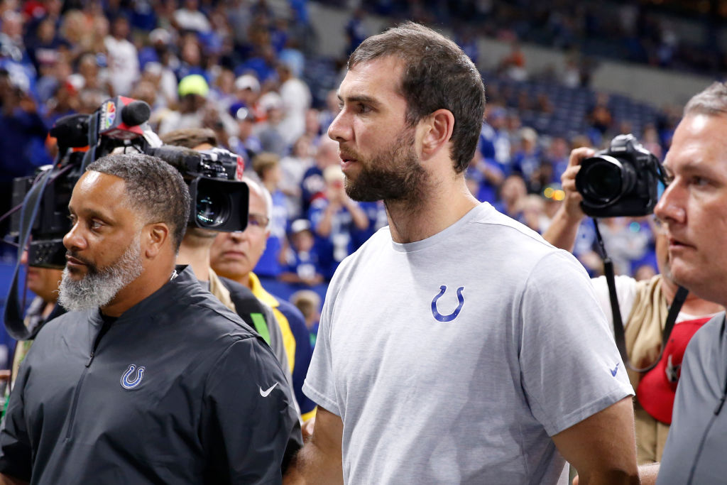 Andrew Luck #12 of the Indianapolis Colts walks off the field