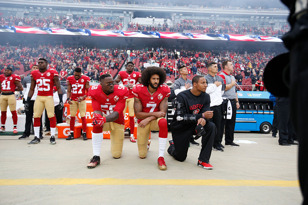 Colin Kaepernick #7 and Eric Reid #35 of the San Francisco 49ers kneel