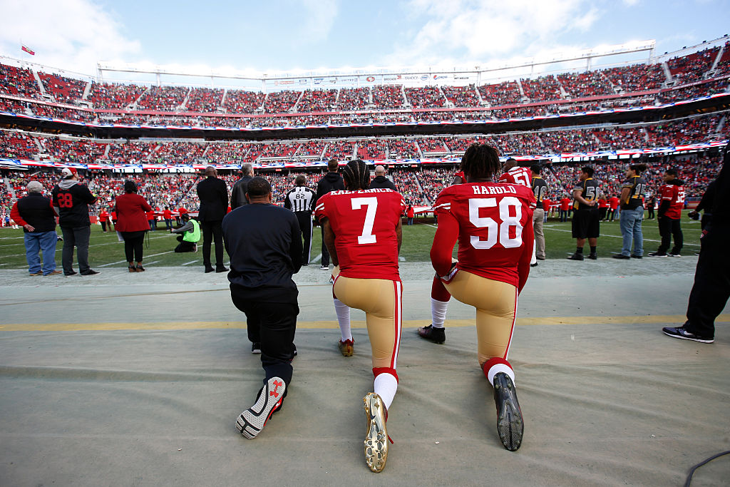 Colin Kaepernick #7 and Eli Harold #58 of the San Francisco 49ers