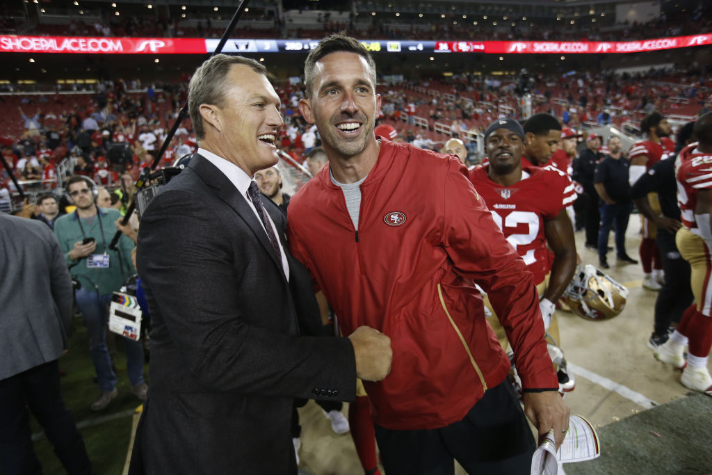 San Francisco 49ers GM John Lynch (left) and coach Kyle Shanahan don't seem to take scouts' opinions into consideration on draft day.