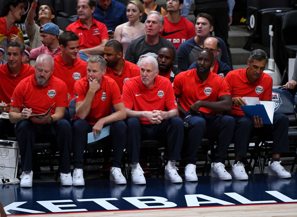 Warriors coach Steve Kerr (front row, second from left) doesn't hold back his praise for Gregg Popovich (front, third from left) and the Spurs.
